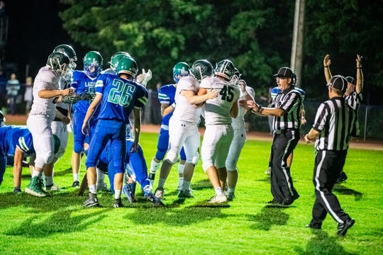 St. Johnsbury celebrates a touchdown during the varsity football game between the Colchester Lakers and St. Johnsbury Hilltoppers in Colchester on Friday September 20.