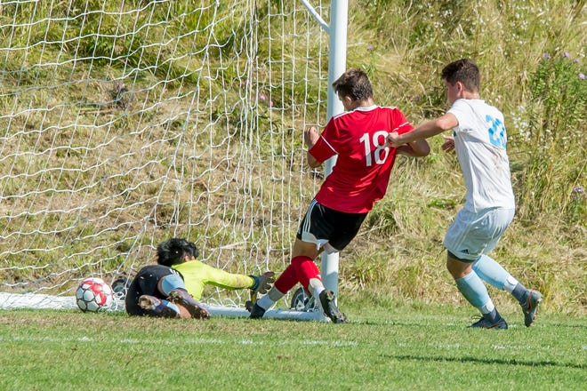 Sam Johnson of Champlain Valley scores in the second half of a 4-1 win over South Burlington in Saturday's high school boys soccer game in Hinesburg.
