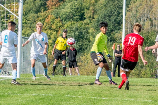 Cullen Swett (No. 19) rediects an Erik Stolen (not pictured) cross into the back of the net for a 2-1 Champlain Valley lead in Saturday's high school boys soccer game vs. South Burlington in Hinesburg.