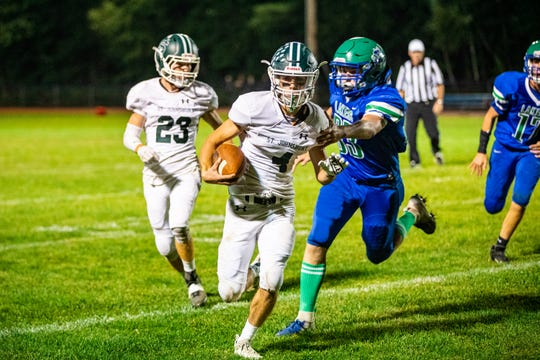 St. Johnsbury's Austin Fenoff carries the ball during the varsity football game between the Colchester Lakers and St. Johnsbury Hilltoppers in Colchester on Friday September 20.