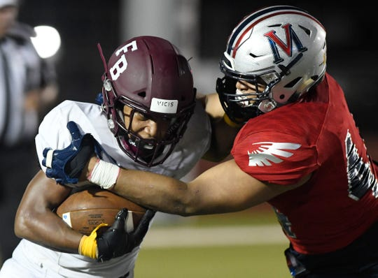 Veterans Memorial defensive lineman #41 Daylan Pena tackles Flour Bluff running back Isaac Miles. Flour Bluff won 21-0 on Friday, Sept. 20, 2019 at Cabaniss Stadium.