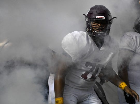 Flour Bluff's Johnny Dickson pauses in smoke before the second half of the game against Veterans Memorial High School, Friday, Sept. 20, 2019, at Cabaniss Stadium. Flour Bluff scored one touchdown the first half of the game.