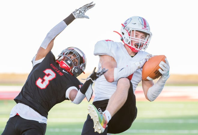 Lenape's Connor Kennedy, right, catches a pass next to Vineland's Jonathan Toney Jr. during the 1st quarter of the high school football game played in Vineland on Friday, September 20, 2019.