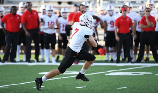 Lenape's Brady Long carries the ball during the 1st quarter of the high school football game between Lenape and Vineland played in Vineland on Friday, September 20, 2019.