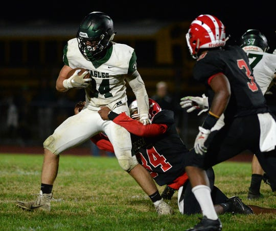 West Deptford's Gavin Sheilds breaks a Delsea tackle as he runs the ball during Friday night's football game at Delsea High School, Sept. 20, 2019.