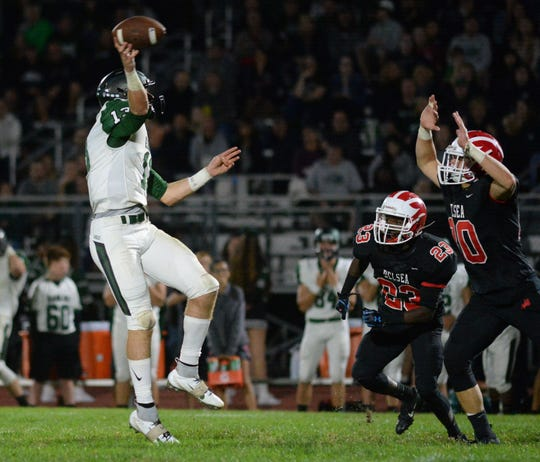 West Deptford's Aaron Graeber throws a pass during Friday night's football game against Delsea at Delsea High School, Sept. 20, 2019.