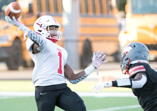 Lenape's Xavier Coleman throws a pass  during the 1st quarter of the high school football game between Lenape and Vineland played in Vineland on Friday, September 20, 2019.