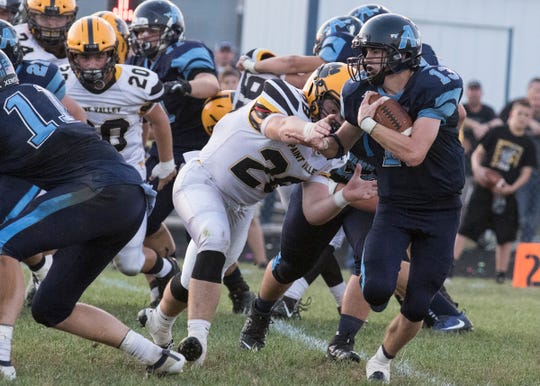 Adena running back Nate Throckmorton runs the ball during a 21-14 loss to Paint Valley on Friday, September 20, 2019, in Frankfort, Ohio.