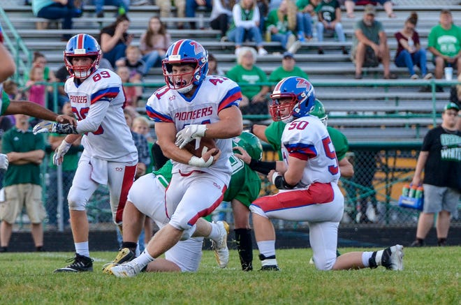 Zane Trace's Cougar Stauffer runs the ball during a 38-6 win over Huntington on Friday, September 20, 2019, in Huntington Township.
