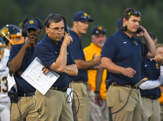 Moeller Crusaders head coach Todd Naumann watches his team against the Winton Woods Warriors on Friday, September 20, 2019, at Winton Woods High School in Forest Park, Ohio