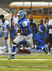 Demeer Blankumsee of the Winton Woods Warriors runs the ball against the Moeller Crusaders on Friday, September 20, 2019, at Winton Woods High School in Forest Park, Ohio