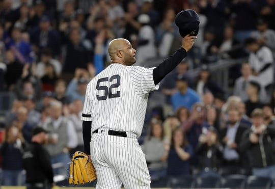 New York Yankees starting pitcher CC Sabathia gestures to fans as he leaves during the third inning of the team's baseball game against the Los Angeles Angels on Wednesday, Sept. 18, 2019, in New York.