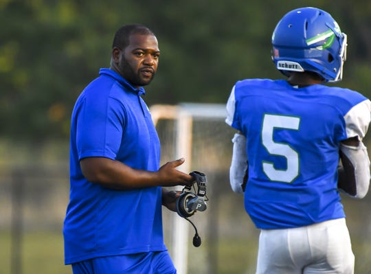 Head coach Andre Parker of the Winton Woods Warriors looks at one of his player against the Moeller Crusaders on Friday, September 20, 2019, at Winton Woods High School in Forest Park, Ohio