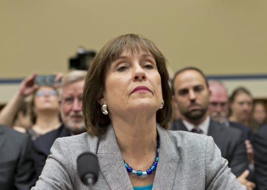 Lois Lerner, head of the IRS unit that decides whether to grant tax-exempt status to groups, listens on Capitol Hill in Washington, Wednesday, May 22, 2013, at the start of a House Oversight and Government Reform Committee hearing to investigate the extra scrutiny the IRS gave to Tea Party and other conservative groups that applied for tax-exempt status. Lerner later invoked her constitutional right to not answer questions and was dismissed by House Oversight Committee Chairman Darrell Issa, R-Calif.