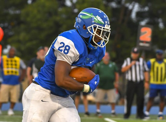 Miyan Williams of the Winton Woods Warriors runs the ball against the Moeller Crusaders on Friday, September 20, 2019, at Winton Woods High School in Forest Park, Ohio