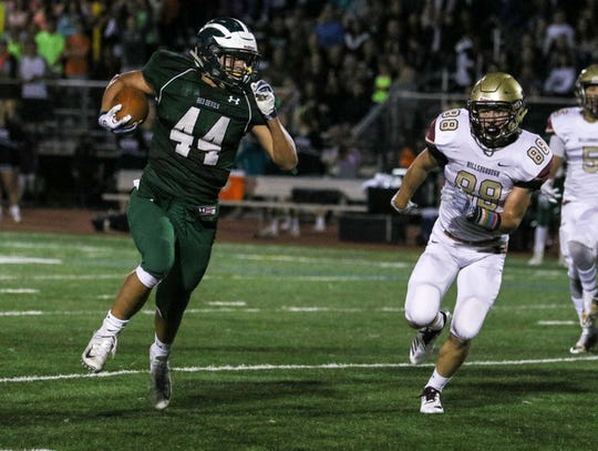 Ridge's Christian Sweeney runs the ball during the first half of a football game against Hillsborough at Ridge High in Basking Ridge on September 28, 2018.    Alexandra Pais/ for the Courier News