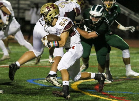 Hillsborough's Sean Levonaitis runs the ball during the first half of a football game against Ridge at Ridge High in Basking Ridge on September 28, 2018.  Alexandra Pais/ for the Courier News