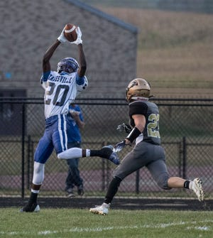 Jamal Wiggins catches a pass to score the first touchdown in a game against River View Friday night.