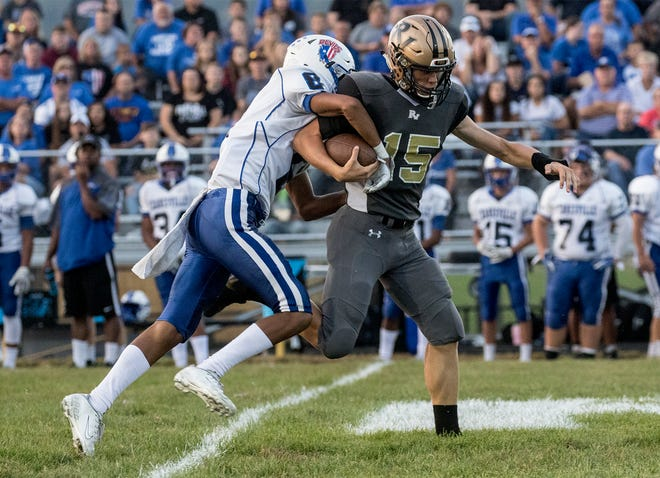 Cal Shrimplin of River View runs the ball down the field against Zanesville's Isaac Mayle last season. Shrimplin will be one of the senior leaders for a young River View squad.