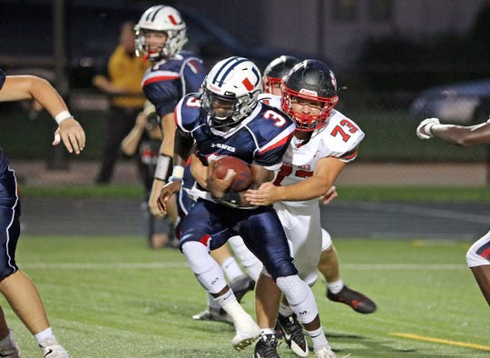 Urbandale senior running back and Northern Illinois commit Harrison Waylee (3) is caught during the Linn-Mar Lions battle against the Urbandale J-Hawks during the Class 4A game on Friday, September 20, 2019 at Frerichs Field.