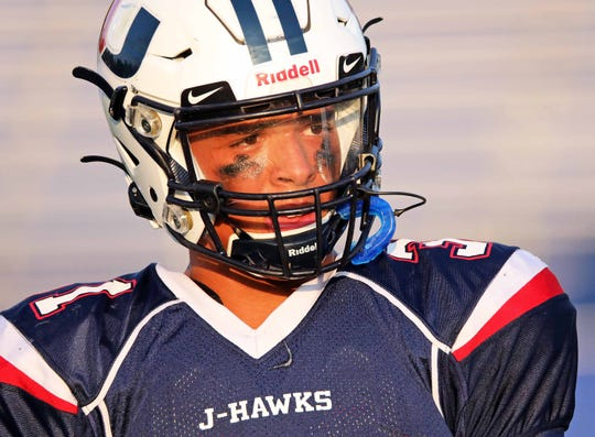 Urbandale junior linebacker and Iowa Hawkeye commit Jaden Harrell (31) warms up before the Linn-Mar Lions battle against the Urbandale J-Hawks during the Class 4A game on Friday, September 20, 2019 at Frerichs Field in Urbandale.