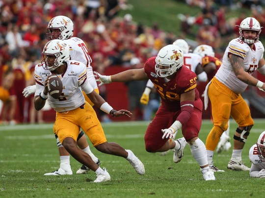 Iowa State defensive lineman Ray Lima (58) pressures ULM quarterback Caleb Evans (6) at Jack Trice Stadium. Evans reached 7,000 career passing yards in Saturday's 72-20 loss to the Cyclones.