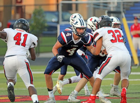 Urbandale junior tight end Max Llewellyn (4) blocks during the Linn-Mar Lions battle against the Urbandale J-Hawks during the Class 4A game on Friday, September 20, 2019 at Frerichs Field in Urbandale.