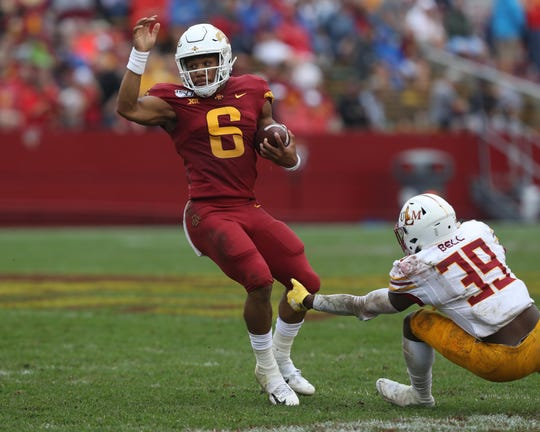Iowa State Cyclones quarterback Re-al Mitchell (6) escapes the tackle from Louisiana Monroe Warhawks safety Bobby Bell (39) at Jack Trice Stadium. The Cyclones beat the Warhawks 72 to 20.