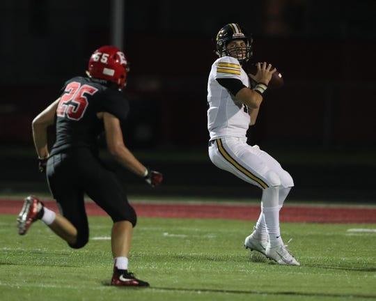 Sept. 20, 2019; Des Moines, IA, USA; SE Polk Rams Jaxon Dailey throws a pass against Des Moines East Scarlets at Williams Stadium.
