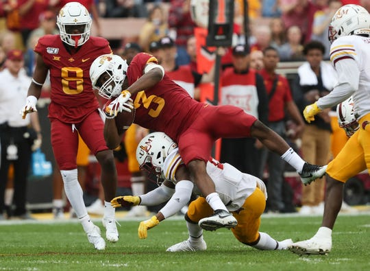 Iowa State Cyclones running back Kene Nwangwu (3) is tackled by Louisiana Monroe Warhawks safety Jabari Johnson (2) at Jack Trice Stadium.