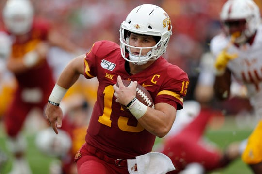 Iowa State quarterback Brock Purdy runs the ball for a first down against Louisiana-Monroe during the first half of an NCAA college football game, Wednesday, Aug. 14, 2019, in Ames.