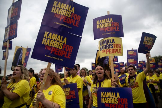 Supporters of U.S. Sen. Kamala Harris, D-CA., march into the Polk County Democrats Steak Fry on Saturday, Sep. 21, 2019, at Water Works Park in Des Moines.