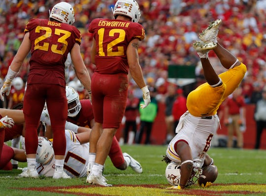 ULM running back Josh Johnson, right, is flipped as he dives into the end zone for a touchdown against Iowa State during the first half of an NCAA college football game, Wednesday, Aug. 14, 2019, in Ames.
