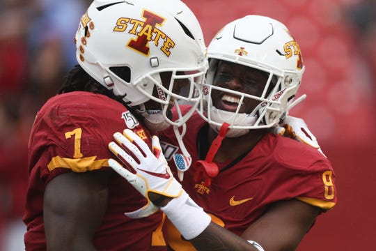 Iowa State Cyclones wide receiver La'Michael Pettway (7) and wide receiver Deshaunte Jones (8) celebrate a touchdown against the Louisiana Monroe Warhawks at Jack Trice Stadium. The Cyclones beat the Warhawks 72 to 20.