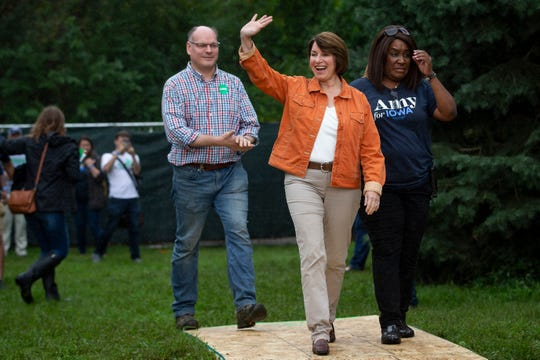 Minnesota Senator and 2020 Democratic presidential candidate Amy Klobuchar walks onstage to speak during the Polk County Democrats Steak Fry in Water Works Park on Saturday, Sept. 21, 2019 in Des Moines.