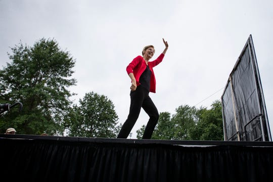 Massachusetts Senator and 2020 Democratic presidential candidate Elizabeth Warren runs onstage to speak during the Polk County Democrats Steak Fry in Water Works Park on Sept. 21, 2019 in Des Moines.