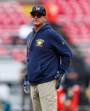 Michigan Wolverines head coach Jim Harbaugh looks on during warmups prior to the game against the Wisconsin Badgers at Camp Randall Stadium, Sept. 21, 2019 in Madison, Wis.