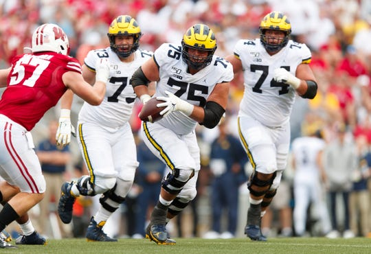 Michigan offensive lineman Jon Runyan Jr. (75) runs with the ball during the fourth quarter against Wisconsin, Saturday, Sept. 21, 2019, in Madison, Wis.