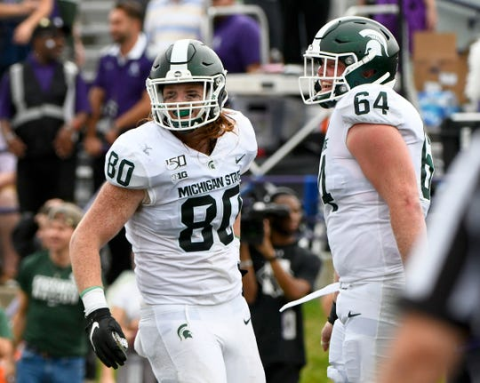 Michigan State tight end Matt Seybert (80) celebrates with offensive lineman Matt Allen (64), after scoring a touchdown against Northwestern during the second half Saturday, Sept. 21, 2019, in Evanston, Ill.