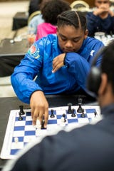 Charisse Woods, 14, plays a round of chess with teammate Micale Garland Jr., 17 during the Detroit City Chess Club at the Detroit Institute of Arts in Detroit, Friday, Sept. 20, 2019.