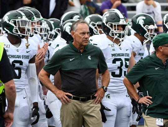 Michigan State head coach Mark Dantonio leads the Spartans onto the field against the Northwestern Wildcats at Ryan Field, Saturday, Sept. 21, 2019, in Evanston, Ill.