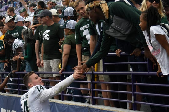 Michigan State quarterback Brian Lewerke celebrates with fans after 31-10 win against Northwestern, Saturday, Sept. 21, 2019, in Evanston, Ill.