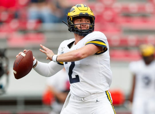 Michigan Wolverines quarterback Shea Patterson passes during warmups prior to the game against the Wisconsin Badgers at Camp Randall Stadium, Sept. 21, 2019 in Madison, Wis.