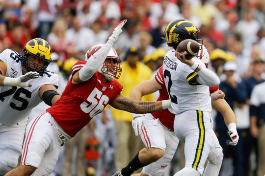 Wisconsin defensive end Rodas Johnson pressures Michigan quarterback Shea Patterson during the first half Saturday, Sept. 21, 2019, in Madison, Wis.