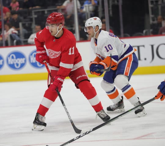 Red Wings right wing Filip Zadina skates against Islanders center Derick Brassard during the first period of the preseason game on Friday, Sept. 20, 2019, at Little Caesars Arena.