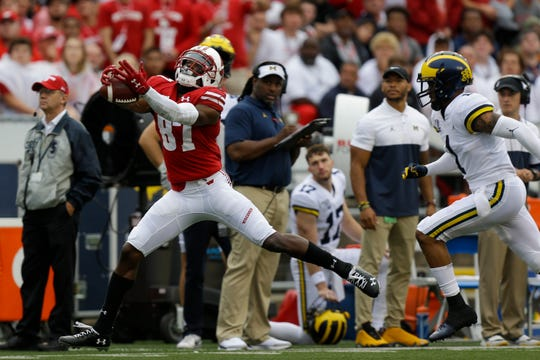 Wisconsin receiver Quintez Cephus makes a first-down reception against Michigan defensive back Ambry Thomas during the first half Saturday, Sept. 21, 2019, in Madison, Wis.