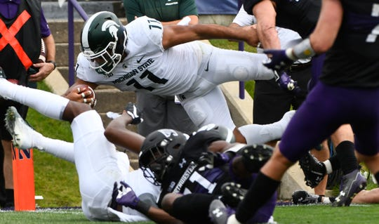 Michigan State running back Connor Heyward dives for the end zone against Northwestern during the second half Saturday, Sept. 21, 2019, in Evanston, Ill.