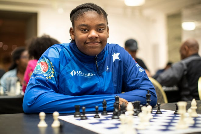 Charisse Woods, 14, poses for a photo during Detroit City Chess Club at the Detroit Institute of Arts in Detroit, Friday, Sept. 20, 2019.