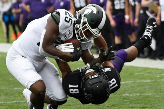 Michigan State receiver Darrell Stewart Jr. catches a pass as Northwestern defensive back Cameron Ruiz (18) defends during the second half Saturday, Sept. 21, 2019, in Evanston, Ill.