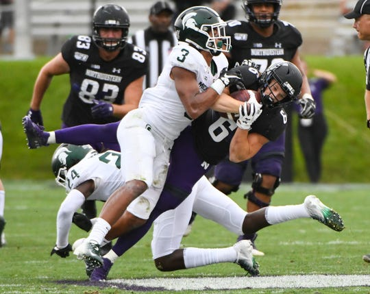 Michigan State safety Xavier Henderson hits Northwestern running back Drake Anderson during the second half Saturday, Sept. 21, 2019, in Evanston, Ill.